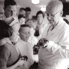 Harbison showing children an arachnid specimen at an open house, June 4, 1961.