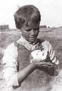 Charles Harbison as a young boy with a guinea pig, on one of his family's ranches.