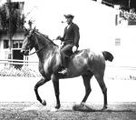 Crosby, pipe in place, was a familiar sight on horseback in the track's early years.