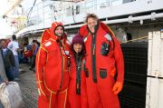 NOAA AMLR researchers don protective suits on the decks of a research ship. Photo Credit: NOAA/SWFSC/Christian Reiss, 2007, Yuzhmorgeologiya